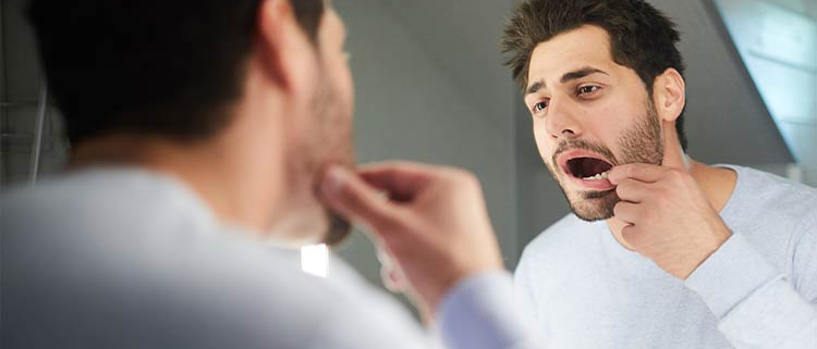 Root Canal Treatment - Man looking in the mirror - Alpha Dental Chester-le-Street